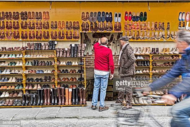 Salesman Shows Potential Customer His Line of Shoes