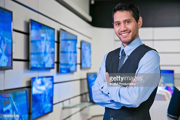 Salesman smiling in store