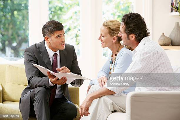 Salesman talking to a middle aged couple