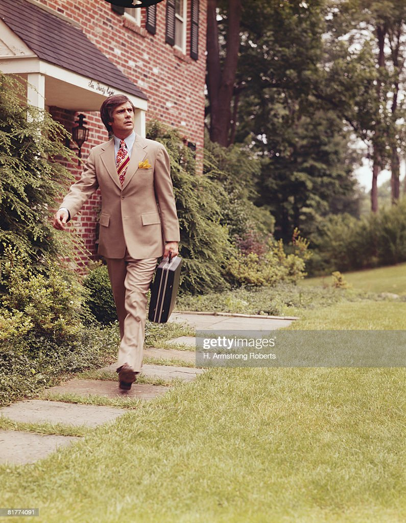 Salesman walking outdoors, on way to work. (Photo by H. Armstrong Roberts/Retrofile/Getty Images) : Stock Photo