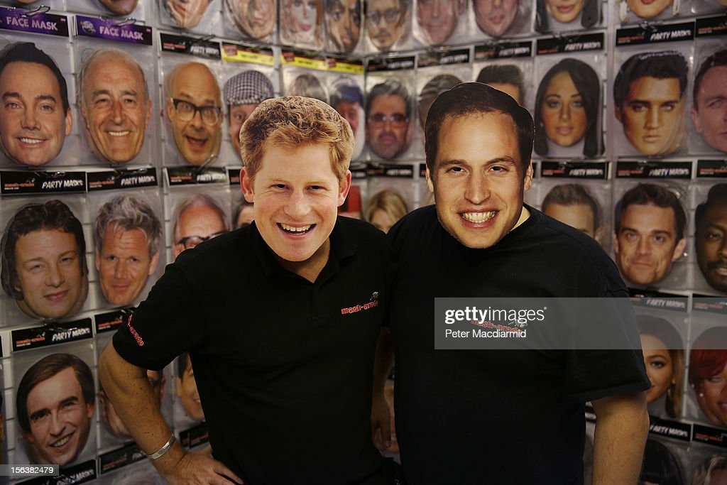Salesman wear <a gi-track='captionPersonalityLinkClicked' href=/galleries/search?phrase=Prince+Harry&family=editorial&specificpeople=178173 ng-click='$event.stopPropagation()'>Prince Harry</a> and Prince William masks at The Ideal Home Christmas Show on November 14, 2012 in London, England. Over 400 exhibitors are showcasing a range of gift ideas for Christmas at the Earls Court exhibition centre.
