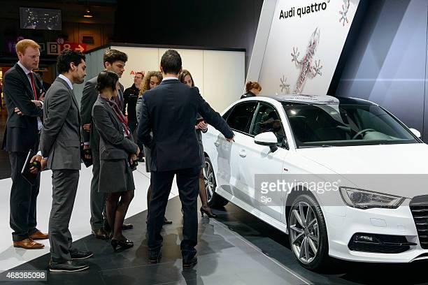 Salesmen and -women and a Audi A3 Berline sedan