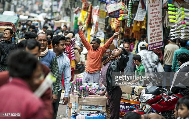 Salespeople sell their products at an open market on the busy streets of New Delhi's Shahjahanabad the walled old city part of India's capital on...