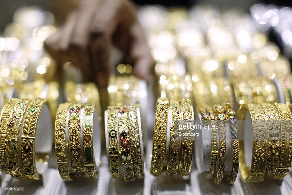 A salesperson arranges gold bracelets in a display cabinet at a jewelry store in Jakarta, Indonesia, on Thursday, Aug. 22, 2013. Gold jewelry demand in Indonesia is set to expand to a four-year high as consumers in Southeast Asia's biggest buyer join India to China in increasing purchases as prices slump and the middle class expands. Photographer: Dimas Ardian/Bloomberg via Getty Images