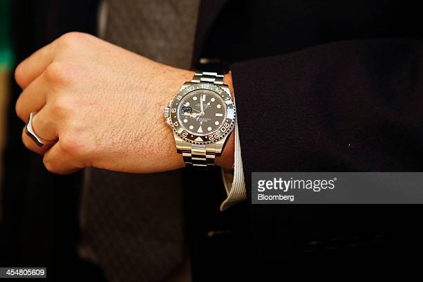 A salesperson displays on Rolex Group watch for a photograph at the GEARYS Rodeo Drive Rolex store in Beverly Hills California US on Monday Dec 9...
