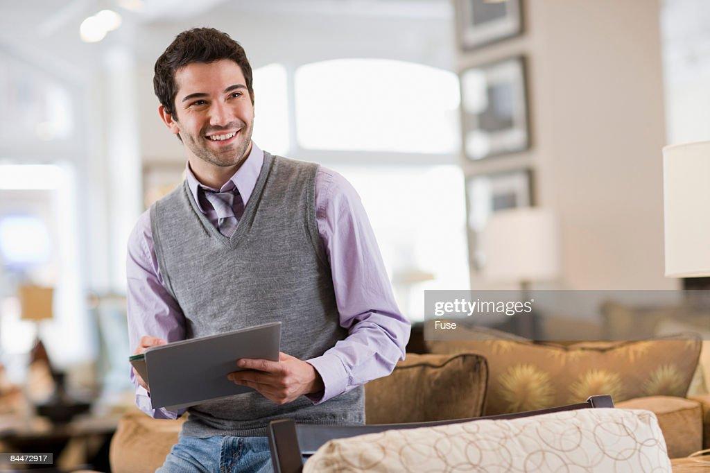 Salesperson Standing in Furniture Store