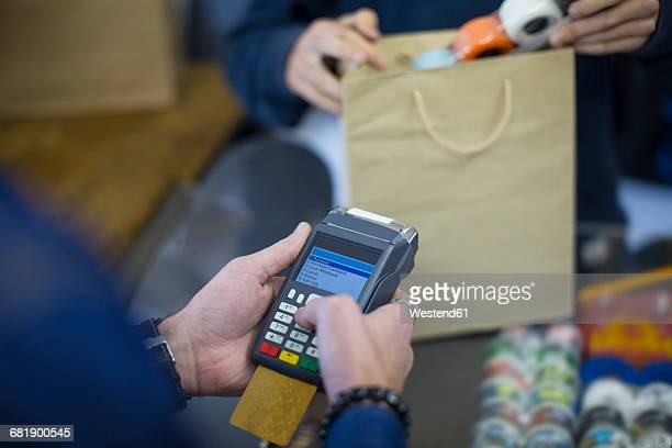 Salesperson using card reader for card payment