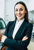 Beautiful manager in work. Salesperson working at car dealership