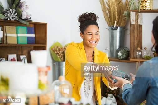 Saleswoman helping customer