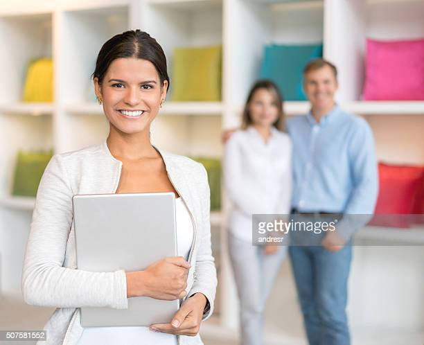 Saleswoman helping customers at a furniture store