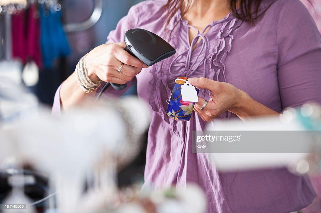 Saleswoman scanning merchandise