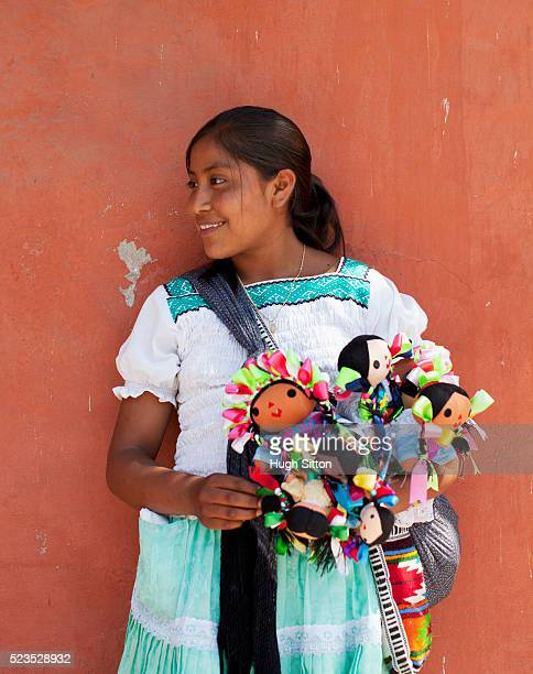 Saleswoman selling Mexican dolls
