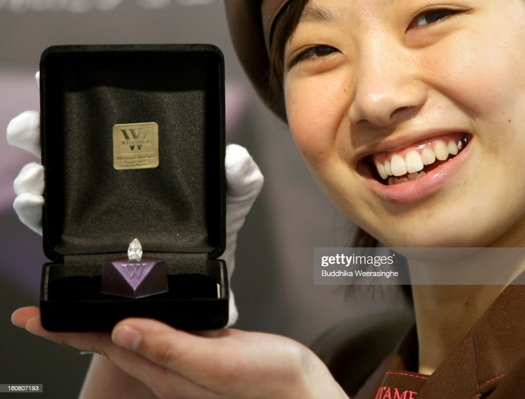 A saleswoman shows piece of diamond shape chocolate with a 2.3 carat diamond in the centre on display at a Hanshin Department Store on February 6, 2013 in Osaka, Japan. The chocolate is priced at 3 million yen (about USD 32,456), making it the world's most expensive chocolate.