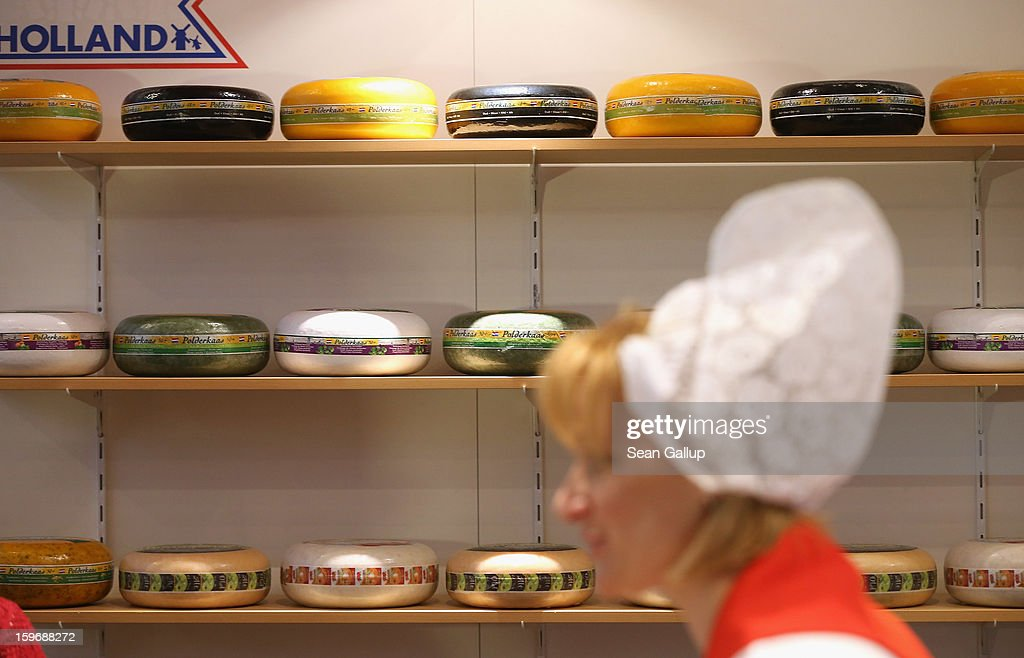 A saleswoman stands among shelves of wheels of Dutch gouda and other cheeses at the 2013 Gruene Woche agricultural trade fair on January 18, 2013 in Berlin, Germany. The Gruene Woche, which is the world's largest agricultural trade fair, runs from January 18-27, and this year's partner country is Holland.