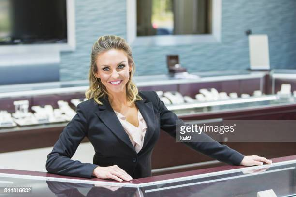 Saleswoman working in jewelry store
