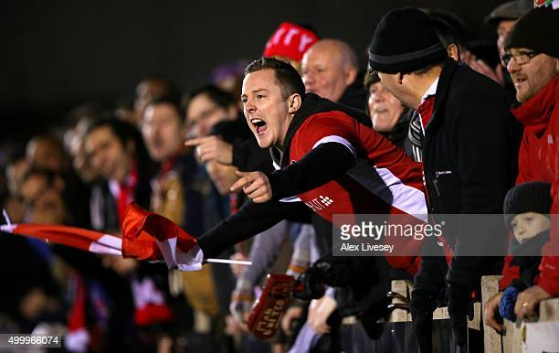 Salford City fans show their support during the Emirates FA Cup Second Round match between Salford City and Hartlepool United at Moor Lane on...