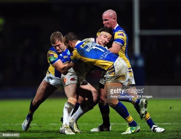 Salford City Reds' Andrew Dixon is tackled by Leeds Rhinos' Paul McShane Jamie JonesBuchanan and Richard Moore during the Super League match at...