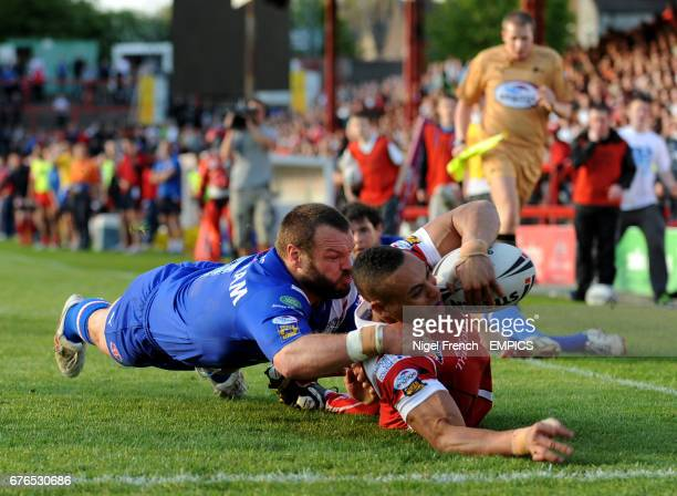 Salford City Reds' Jodie Broughton scores a try in the corner under pressure from St Helens' Keiron Cunningham