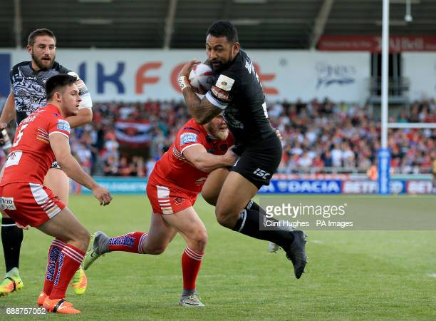 Salford Red Devils' Josh Jones tackles Catalans Dragons Kristian Inu during the Betfred Super League match at the AJ Bell Stadium Salford