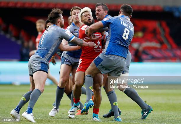 Salford Red Devils' Junior Sa'u is tackled by Wakefield Trinity's Scott Grix and Anthony England during the Ladbrokes Challenge Cup quarterfinal...