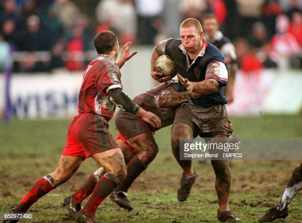 Salford Reds' Warren Jowitt attempts to get through the defence of the Leigh Centurions
