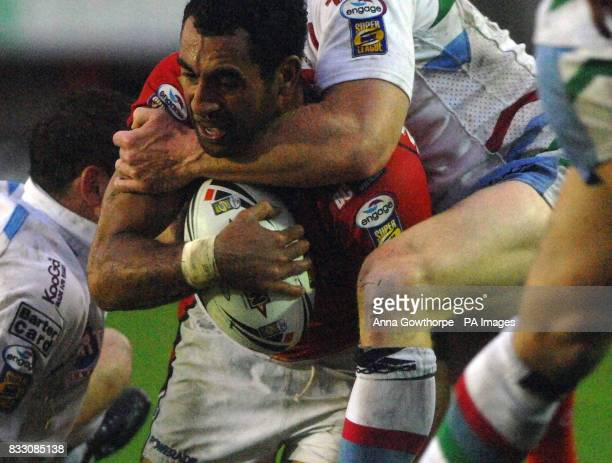 Salford's John Wilshere is tackled by Harlequins' Matt Gafa during the engage Super League match at The Willows Salford