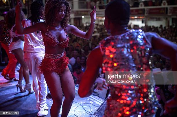 Salgueiro samba school dancers perform during a group's rehearsal for the upcoming carnival in Rio de Janeiro Brazil on February 1 2014 AFP PHOTO /...