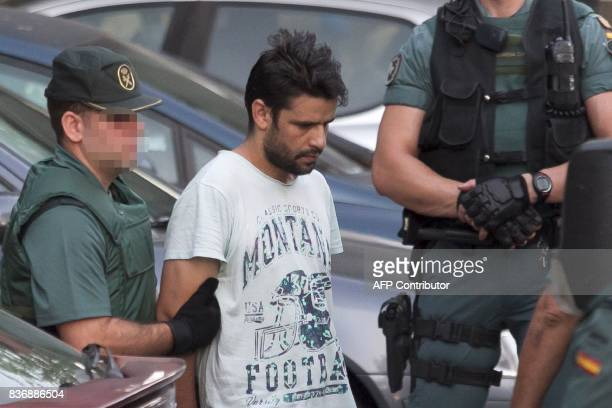 Mohamed Aallaa suspected of involvement in the terror cell that carried out twin attacks in Spain is escorded by Spanish Civil Guards from a...