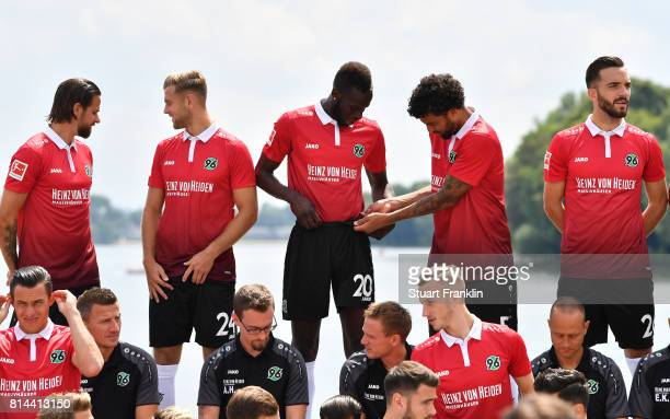Salif Sane and Felipe of Hannover 96 adjust their kit during the team presentation at on July 14 2017 in Hanover Germany
