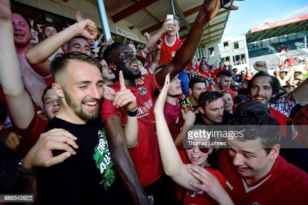 Salif Sane and the player of Hannover 96 celebrate with their supports after the Second Bundesliga match between SV Sandhausen and Hannover 96 at...