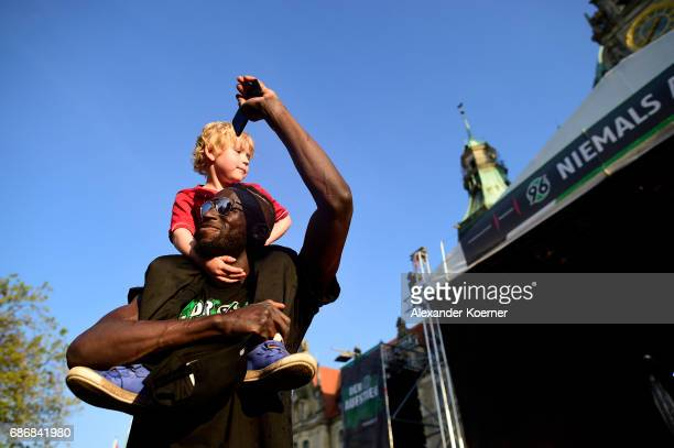 Salif Sane of German club Hannover 96 celebrates its promotion to 1 Bundesliga at Neues Rathaus on May 22 2017 in Hanover Germany Hannover 96 secured...