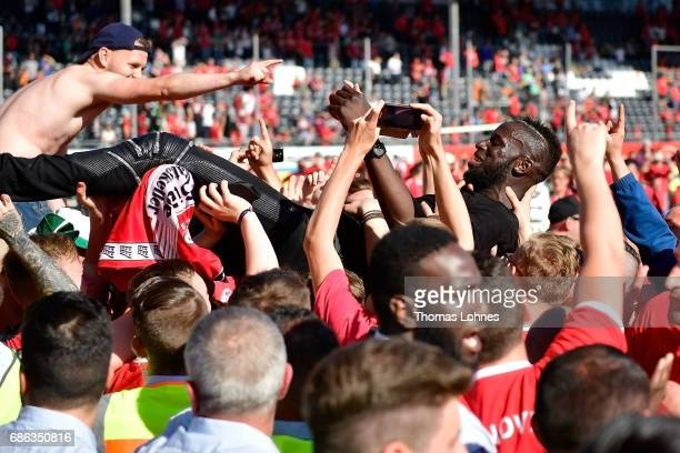 Salif Sane of Hannover 96 celebrates with supporterss after the Second Bundesliga match between SV Sandhausen and Hannover 96 at Hardtwaldstadion on...
