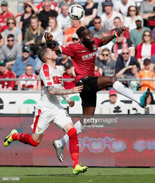 Salif Sane of Hannover 96 jumps for a header with Daniel Ginczek of VfB Stuttgart during the Second Bundesliga match between Hannover 96 and VfB...