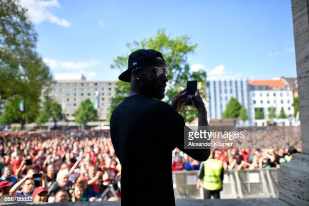 Salif Sane of Hannover 96 takes a photo with his smartphone while celebrating their promotion to 1 Bundesliga at Neues Rathaus on May 22 2017 in...
