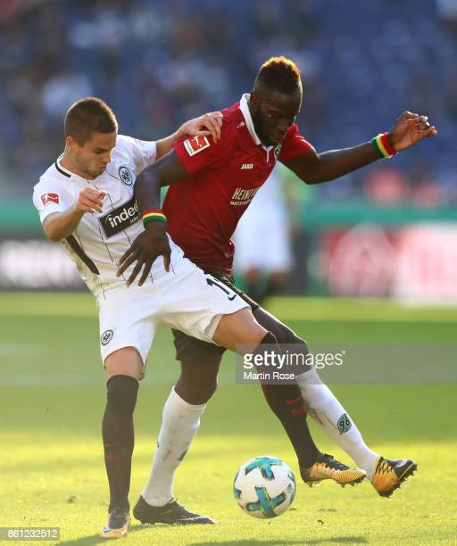 Salif Sane of Hannover and Mijat Gacinovic of Frankfurt battle for the ball during the Bundesliga match between Hannover 96 and Eintracht Frankfurt...