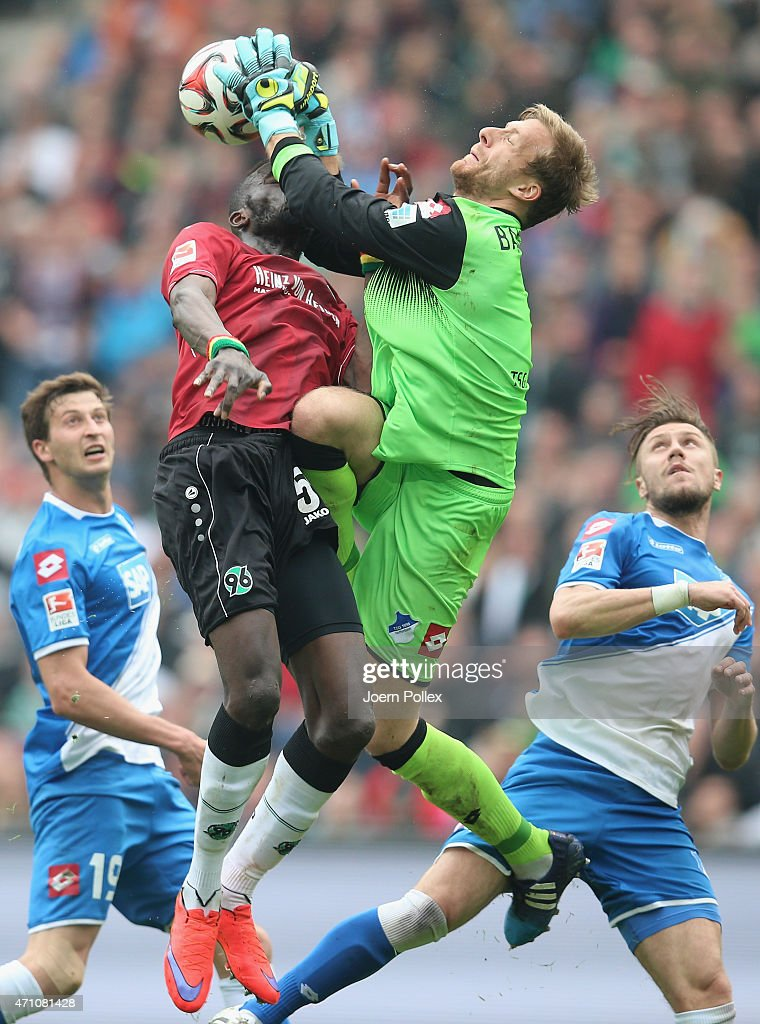 Salif Sane of Hannover and <a gi-track='captionPersonalityLinkClicked' href=/galleries/search?phrase=Oliver+Baumann&family=editorial&specificpeople=4645207 ng-click='$event.stopPropagation()'>Oliver Baumann</a> of Hoffenheim compete for the ball during the Bundesliga match between Hannover 96 and 1899 Hoffenheim at HDI-Arena on April 25, 2015 in Hanover, Germany.