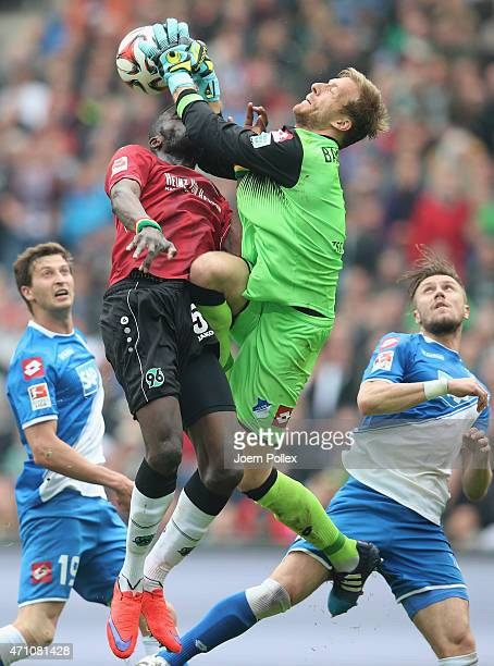 Salif Sane of Hannover and Oliver Baumann of Hoffenheim compete for the ball during the Bundesliga match between Hannover 96 and 1899 Hoffenheim at...