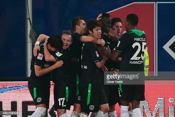 Salif Sane of Hannover celebrates with teammates after heading his team's first goal during the First Bundesliga match between Hamburger SV and...