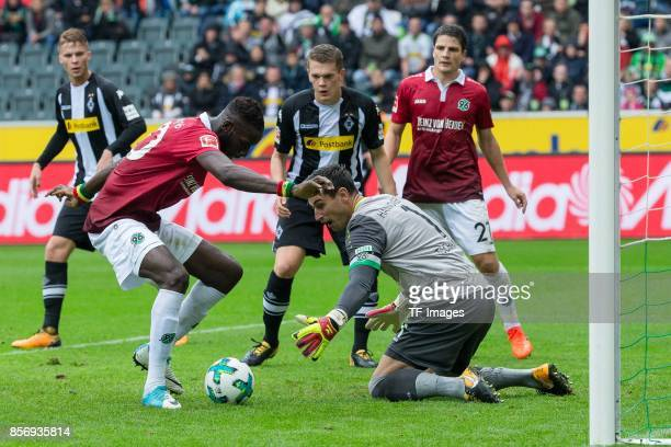 Salif Sane of Hannover Goalkeeper Philipp Tschauner of Hannover controls the ball during the Bundesliga match between Borussia Moenchengladbach and...