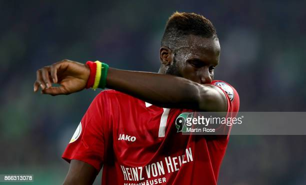 Salif Sane of Hannover reacts during the DFB Cup match between VfL Wolfsburg and Hannover 96 at Volkswagen Arena on October 25 2017 in Wolfsburg...