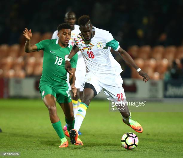 Salif Sane of Senegal holds of Alex Iwobi of Nigeria during International Friendly match between Nigeria against Senegal at The Hive Barnet FC on...
