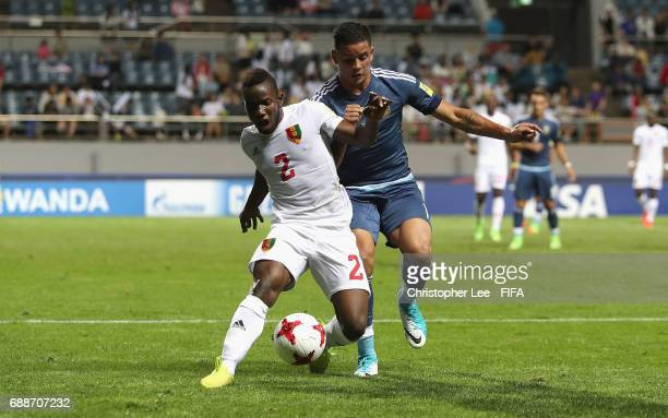 Salif Sylla of Guinea holds off Brian Mansilla of Argentina during the FIFA U20 World Cup Korea Republic 2017 group A match between Guinea and...