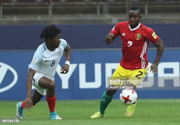 Salif Sylla of Guinea is chased by Ainsley MaitlandNiles of England during the FIFA U20 World Cup Korea Republic 2017 group A match between England...