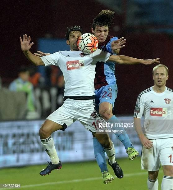Salih Dursun of Trabzonspor vies with Muhammet Demir during a Turkish Spor Toto Super League soccer match between Trabzonspor and Gaziantepspor at...