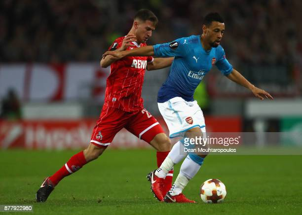 Salih Oezcan of FC Koeln and Francis Coquelin of Arsenal battle for possession during the UEFA Europa League group H match between 1 FC Koeln and...