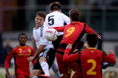 Salih Oezcan of Germany goes up for a header during the Under 16 Juniors International Friendly match between U16 Belgium and U16 Germany at Damburg...