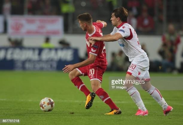 Salih Oezcan of Koeln and Filip Stojkovic of Belgrad battle for the ball during the UEFA Europa League group H match between 1 FC Koeln and Crvena...