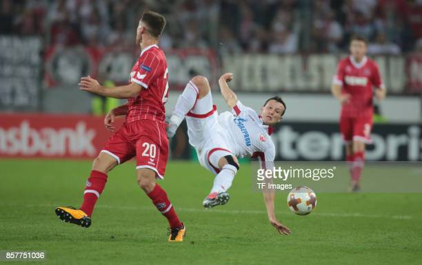 Salih Oezcan of Koeln and Slavoljub Srnic of Belgrad battle for the ball during the UEFA Europa League group H match between 1 FC Koeln and Crvena...