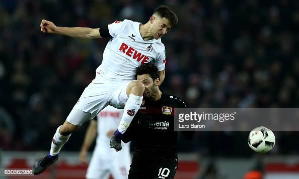 Salih Oezcan of Koeln challenges Hakan Calhanoglu of Bayer Leverkusen during the Bundesliga match between 1 FC Koeln and Bayer 04 Leverkusen at...