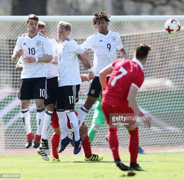 Salih Oezcan Robin Hack and Etienne Amenyido of Germany try to block a freekick of Luka Adzic of Serbia during the UEFA Elite Round match between U19...